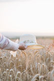 Woman holding straw hat Stock Photos