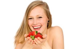 Woman holding strawberries in her hands Stock Photography