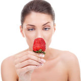 Woman holding strawberry Stock Photos