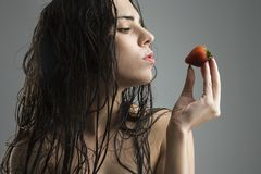 Woman holding strawberry. Royalty Free Stock Images