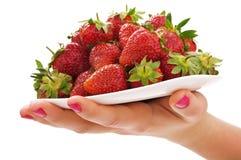 Woman holding strawberry Stock Photos