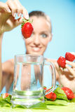 Woman holding a strawberry Royalty Free Stock Photo