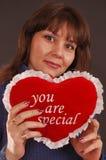 Woman holding stuffed heart Royalty Free Stock Photos