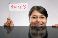 Woman holding success flag Stock Photos