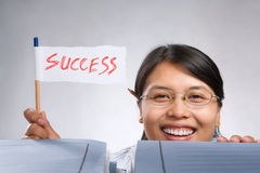 Woman holding success flag Stock Image