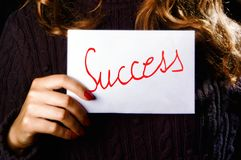 Woman holding the success word Royalty Free Stock Image
