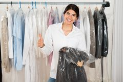 Woman holding suit in shop Royalty Free Stock Photography
