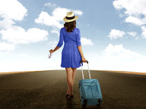 Woman Holding Suitcase Walking On The Road Stock Photo