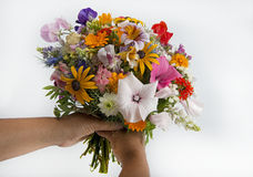 Woman holding a summer flower bouquet Royalty Free Stock Image
