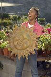 Woman Holding Sun's Sculpture Stock Photos