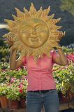 Woman Holding Sun's Sculpture In Front Of Face Royalty Free Stock Photo