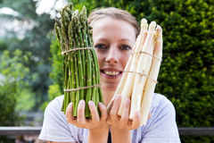 Woman is holding sundry asparagus Royalty Free Stock Photography