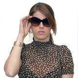 Woman holding sunglasses Stock Photography