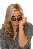Woman holding sunglasses Royalty Free Stock Photo