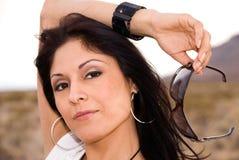 Woman holding sunglasses. Stock Photos