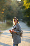 Woman holding sunglasses in hand on sunlight Royalty Free Stock Photo