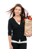 Woman holding a supermarket paper shopping bag Stock Images