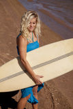 Woman holding surf board Royalty Free Stock Image