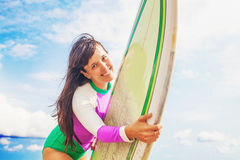 Woman holding a surf board Stock Photo