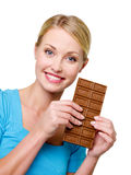 Woman holding the sweet black bar of chocolate Royalty Free Stock Image