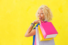 Woman holding swhopping bags over her shoulder Royalty Free Stock Photos