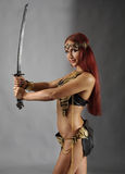 Woman holding sword in her hand Stock Photo