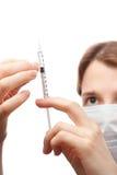 Woman holding syringe Royalty Free Stock Images