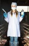 Woman holding syringe and bottle Royalty Free Stock Photos
