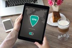 Woman holding tablet app vpn creation Internet protocols protect Stock Photos