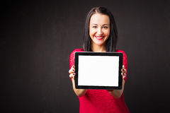 Woman holding tablet with blank screen Stock Image