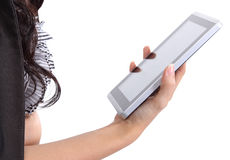 Woman holding tablet. Closeup image of asian woman holding tablet in her hand on white background Stock Photography