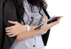 Woman holding tablet. Closeup image of asian woman holding tablet in her hand on white background Stock Photo