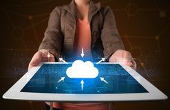 Woman holding tablet with cloud icon. Casual young woman holding tablet with cloud concept Royalty Free Stock Image