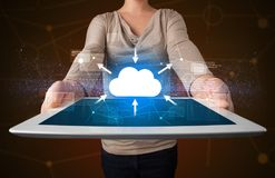 Woman holding tablet with cloud icon. Casual young woman holding tablet with cloud concept Stock Photo