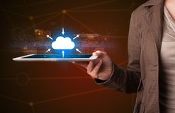 Woman holding tablet with cloud icon. Casual young woman holding tablet with cloud concept Royalty Free Stock Images