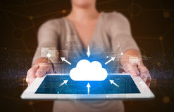Woman holding tablet with cloud icon. Casual young woman holding tablet with cloud concept Stock Photos