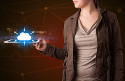 Woman holding tablet with cloud icon. Casual young woman holding tablet with cloud concept Stock Images