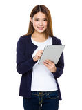Woman holding tablet computer isolated on white background Royalty Free Stock Photo