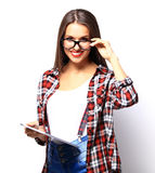 Woman holding tablet computer isolated on white background Stock Images