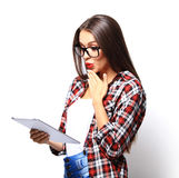 Woman holding tablet computer isolated on white background Royalty Free Stock Photos