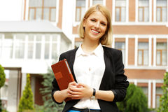 Woman holding tablet computer outdoors Stock Image