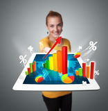 Woman holding tablet with graphs and diagrams Stock Photo