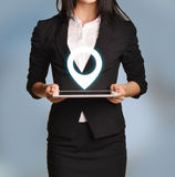 Woman is holding tablet with location icon.  Royalty Free Stock Photo