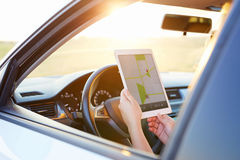 Woman holding tablet with map gps navigation Royalty Free Stock Photography