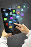 Woman holding a tablet with modern colorful floating apps and icons. Royalty Free Stock Photo
