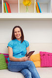 Woman holding the tablet pc Royalty Free Stock Image