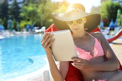 Woman holding tablet pc Stock Images