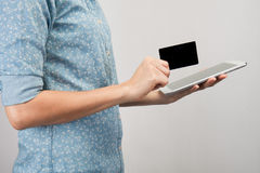Woman holding tablet pc and credit card indoor, Shopping Online Royalty Free Stock Image