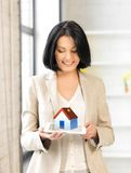 Woman holding tablet pc with house illustration Stock Image