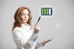 Woman holding tablet and pen, battery level icon Stock Photos